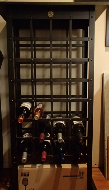 My wine rack.  It sits in my basement which is typically about 5-7 C cooler than my upstairs. Not optimal temperature (which is 10C, and my basement is probably about 14-16C, but it's dark down here, and with none of these being screwtops, I'm rotating regularly