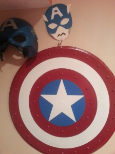 Somebody REALLY likes Captain America in my family!  This is the shield my husband made for our daughter, and it hangs on the wall in her room.